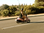 I've been using this pink moped to get around! It's soooo much fun. It goes about 55kph (34 mph) so no worries about speeding tickets :)